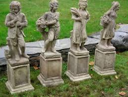 antique cast garden statues depicting the four