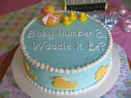 pink and teal rubber duck baby shower cake