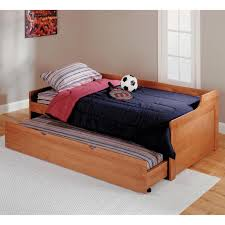 two day beds with trundles against the low wall serve as seating