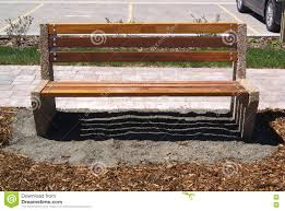 Wooden Park Bench Wooden Park Bench Sitting On Grey Gravel And Mulch Stock Photo