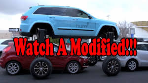 modified jeep cherokee watch a modified jeep grand cherokee glide over traffic hum