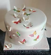 airbrushed cake covered in fondant with butterflies out