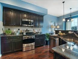 blue kitchen walls with brown cabinets pin by susan kuonqui on design studio blue kitchen walls