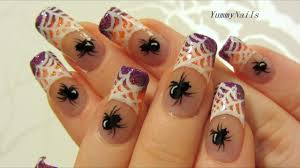 spiderweb on purple and orange glitter halloween design nail art