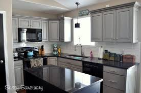 light grey kitchen cabinets with black appliances black appliances and white or gray cabinets how to make it