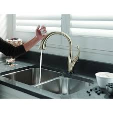 lowes kitchen faucets delta bathroom corian countertop with kraus sinks and gold delta touch