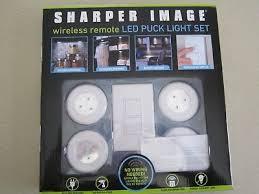 sharper image wireless remote led puck lights sharper image wireless remote led puck light set 4 lights no wiring