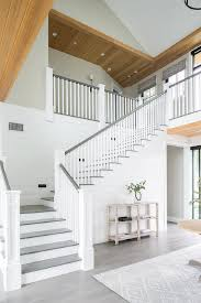 white staircase with gray stair treads and railing transitional