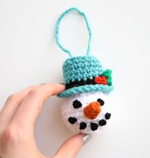 one sheepish snowman ornament and a white crochet