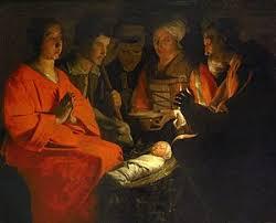 santa kneeling at the manger nativity of jesus in