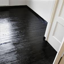 wood floor painted black gotta do it good bye carpet in hall