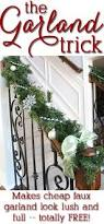 How To Decorate Banister With Garland How To Decorate With Christmas Garland And Live Greenery