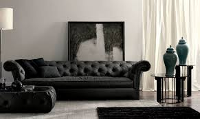 elegant living room decor with black sofa and wall painting
