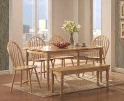 natural wood dining table by coaster