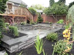 landscaping ideas for downward sloping backyard the garden