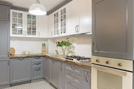white kitchen cabinets refinishing 2021 cost to paint kitchen cabinets professional repaint