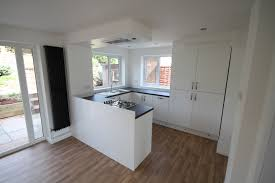 White Kitchen Ideas Uk by Gloss White Kitchen With Flush Ceiling Extractor Plinth Lighting
