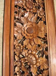 carved floral wood panel