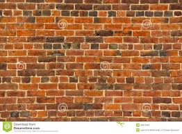 old red brick wall with lots of texture and color stock image