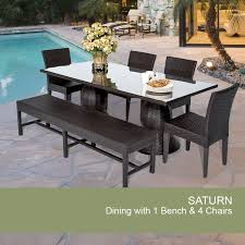 outdoor dining set with brown wicker chairs and large square glass