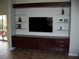 brown wooden wall mounted media cabinet with storage and drawer