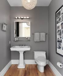 Laminate Flooring In A Bathroom Gray Wall Paint Mirror With Frame Washbasin With Pedestal Wooden