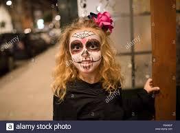 halloween stock footage blond little with sugar skull makeup at halloween stock photo