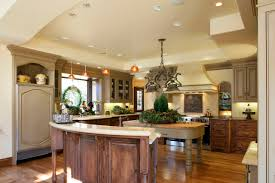 dining room pendant lighting with curved countertop and wood