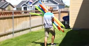 Backyard Agility Course Mom Spots Dad Hauling 20 Pool Noodles In The Backyard Now Watch