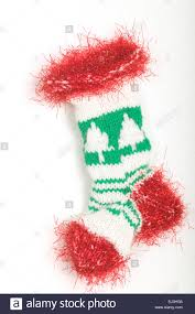 knitted christmas tree patterns christmas lights decoration knitted christmas stocking with a christmas tree pattern and red fluffy trim stock photo