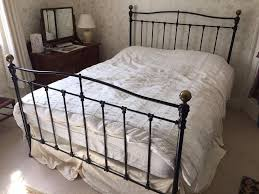 tubular metal iron kingsize bed frame black brass colour in