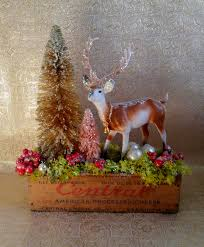 vintage cheese box deer arrangement bottle brush trees moss