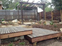 Native Garden Ideas by Native Shrubs And Grasses Around A Dry Riverbed With Recycled