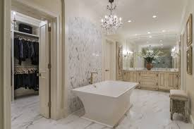 interior designer crush ami austin a beautiful italian chandelier that enhanced and complemented flanking wall sconces combined with stunning crystal