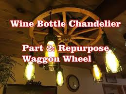 Beer Bottle Chandelier Diy Wine Bottle Chandelier Part 2 Repurposed Wagon Wheel Youtube