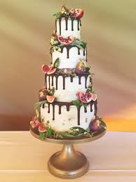 chocolate drip semi wedding cake with gilded figs