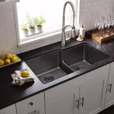 kitchen brushed nickel elkay sinks and white tile backsplash with
