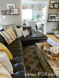 living room luxurious schemes with bay window credited loversiq how to style a dark leather sofa den makeover beneath my heart we swapped out the