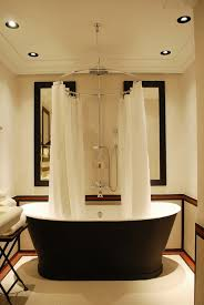 stunning bathroom love the striking black bathtub u0026 the circular