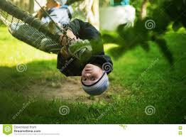 kid hanging hammock upside down backyard background stock photo