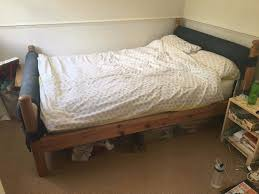 wooden double bed frame with upholstered head and foot board no
