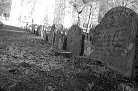 pictures of tombstones row of tombstones from the 1700 s lead into the distance stock