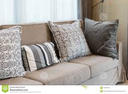 brown tweed sofa with grey pillows stock photo image 56338403