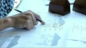 House Blueprint by Developing Engineering Project Male Architect Checking Numbers On