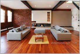 comfy gray sofa dark finish hardwood bun foot round shaped ottoman
