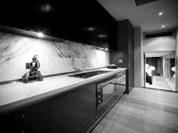 modern kitchen design ideas with black glossy kitchen cabinetry