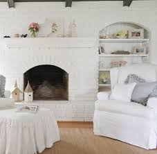 lovely white brick fireplace living room traditional with wood