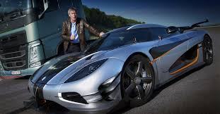 blue koenigsegg one 1 tiff needell races a volvo truck against the koenigsegg one 1 on a