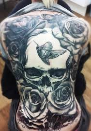 great skull with butterflies and roses on whole back