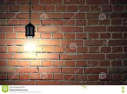 light bulb on dark brick wall background stock photo image 74341313
